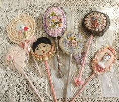 Powder patters... 1920's French ribbonwork collection.  During the 1920's and into the 30's, homemakers loved to make things in their home pretty (some things never change, do they?).