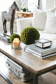 How to Style a Coffee Table. Now that our children are passed the toddler years - I just may be able to start styling our coffee tables again!