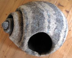 Monika Pioch's Blog - many in-progress shots of her wet-felted Cat Caves, some with floral or starburst openings, some with shell-like folds, some with markings like gray river rocks. Lots of fun things here.