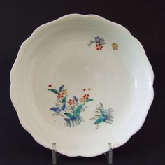 A Japanese Kakiemon Nigoshide Porcelain Tripod Dish c.1680-1700. Decorated with Two Groups of Plants and Grasses Tied with Blue Ribbons Similar to if not `Banded Hedges`.