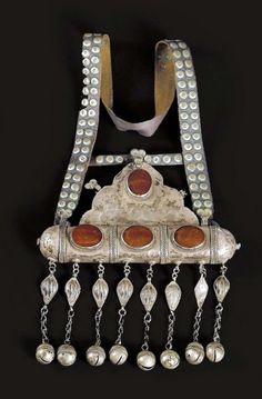 Turkestan | Amulet; silver and carnelian, with a studded leather strap ~ tumar. | Esari people | ca. 20th century