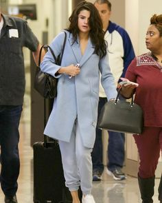 Selena Gomez Shows How to Wear Sweatpants With Class at the Airport | via Vogue  Traveling today can be a hellish ordeal though the right outfit can elevate the mood. Arriving in Atlanta yesterdaySelena Gomezdemonstrated how to make the comfytravel lookalittle more polished. The singer often keeps things ladylike but lo-fi when on the road and this time she loosened up her outfit a step further with cozy sweatpants.  That touch of athleisure was elevated thanks to the tailoring of her powder…
