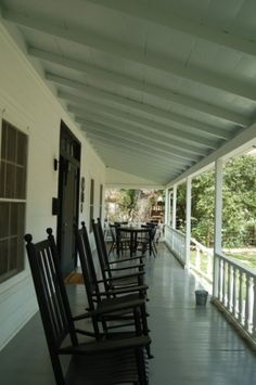 Dining or card playing at one end and rocking chairs at the other. Southern Charm.