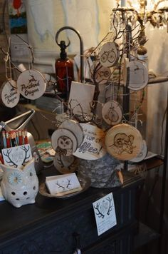 SPOTLIGHT PHOTO: NICOLE THILL - Small pieces of artwork created by Rachel Burr are on display in Woodland Cottage. Burr, who works as a wood-burning artist, will be at the store on March 31 to talk about her creative techniques.