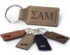 x leather-like rectangle keychain. Design engraved on one side. Chi Psi, Alpha Chi Omega, Alpha Phi Letters, Sk Logo, Wooden Greek Letters, Engraved Tumblers, Tri Delta, Delta Zeta, Delta Chi