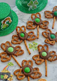 You'll need just four easy ingredients and a few minutes to make these ADORABLE Shamrock Pretzel Treats perfect for celebrating St. Patrick's Day!