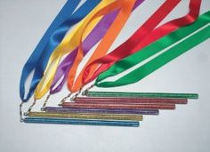 Sportime Rainbow Streamer Satin Ribbon Glitter Wands - 36 Inches - Set of 6 by Everrich Ind Inc. Save 25 Off!. $15.99. Assorted colors of the rainbow. From School Specialty, the leader in education solutions. Glittery plastic wand for gripping. Ideal for music and dance. Set of 6. These beautiful, high-quality rainbow streamer ribbons come in sets of 6 (one each; red, yellow, blue, green, violet and orange). Each streamer has a long, satin ribbon with a 9 inch (23cm) plastic wand that spa...