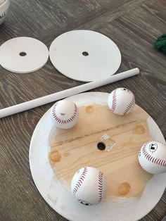 """I wanted to create a tiered stand for displaying treats when everyone comes over to watch a baseball game. It was time to get creative! I purchased a dozen baseballs and drilled holes all the way through five of them with a 7/8"""" drill bit."""