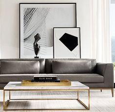 RH Modern's Nicholas Marble Square Coffee Table:Pairing marble's luminous warmth with metal's cool luster, this table designed by the Van Thiels is a study in complementary contrasts. Inspired by a 1960s French original, it is a striking surface for display.