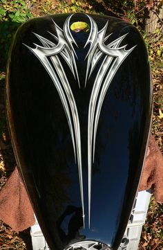 Black basecoat with metal effect airbrushed tribal graphics.