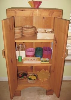 Child's own cupboard in the kitchen/main living area ... helps their ability to reach everything they need and participate #waldorf