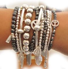 Stack of silver and black bracelets