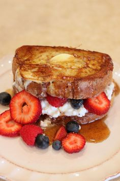 French toast, cottage cheese and berries; use egg whites and almond milk and Pam spray to make french toast (with vanilla extract, cinnamin and a dash of sugar of course!)