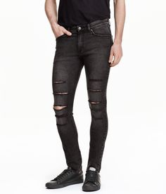 5-pocket, low-rise jeans in washed stretch denim with heavily distressed details, zip fly, and super-skinny legs.| H&M Divided Guys