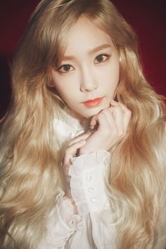 Taeyon of SNSD, Girl's Generation, looks like a goddess here with her hair long and wavy.