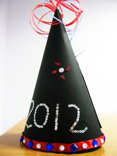 Time to don those party hats! 'New Year Hat' is a fun craft activity that gives kids ideas on how they can make their very own funky party hats! Craft Activities, Preschool Crafts, Crafts For Kids, Arts And Crafts, New Year's Eve Crafts, Holiday Crafts, Holiday Ideas, New Years Hat, New Year's Eve Celebrations