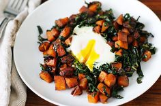 Sweet potato kale hash plated, like Egg Harbor Cafe, change onions to sweet and add red bell pepper when cooking onions...