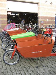 You can also tour the city by bike. You have a couple different options with children. If the kids are old enough, you can each rent your own or you can rent a two-person tandem bike. If you really want to be Dutch and fit in, get a bakfiets. A bakfiets has a little seating area on the front of the bike (it almost looks like a wheelbarrow or box), so young kids can ride up front.