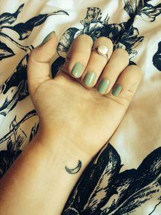 Small crescent moon tattoo
