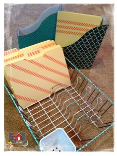 Dish drainer used for organizing files, etc.! The cup in the corner could be used for pencils or dry erase markers (if your file folder games are laminated).  Or take the cup off completely.