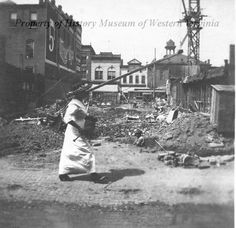 The excavation for the McGuire Building, located at Campbell Avenue and First Street (Market Street) SE in Roanoke, Virginia. The excavation took place circa 1913-1914. History Museum of Western Virginia