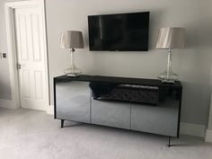 Our elegant BOOK modular sideboard on legs. Sideboard with mirrored front doors and black matt glass frame. Delivered to our client in Surrey.