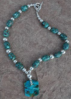 Turquoise and sterling silver is such a classic combination. And, the artist really let the natural beauty of the stones take center stage. Necklace, Makoce Designs