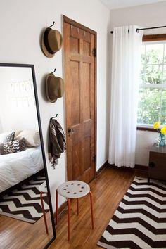 Dark wood, white walls: Jen & Omar's Inspired Apartment House Tour | Apartment Therapy #oldhouseideas