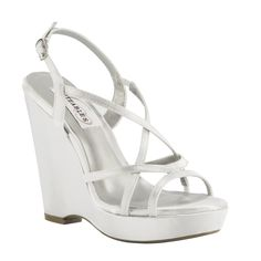 Dee is a wildly popular wedge sandal that is perfect for any outdoor or indoor event. The generous platform adds a bit of comfort on this sexy 4 inch heel. #WeddingShoeInspirations