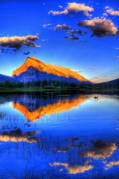 Rundle mountain, banff.  Reflection with Clouds
