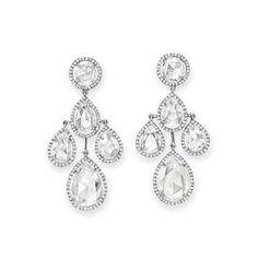 A PAIR OF DIAMOND EAR PENDANTS, BY DAVID MORRIS Of girandole design, each suspending a tassel of four pear-shaped rose-cut diamonds, each within a single-cut diamond surround, from the rose-cut diamond surmount of similar design, mounted in platinum.