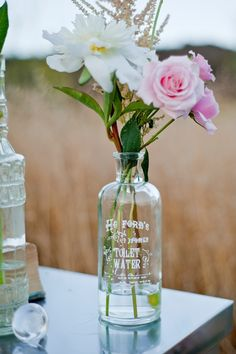 Vintage bottles make the perfect addition to your outdoor wedding decor