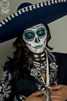Dia De los Muertos , Day of the Deas, sugar skull paint and costuming.  Procession, November 1st & 2nd tradional custom of Mexico.  Sombrero and jaket