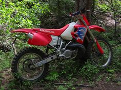 1993 Honda CR250. I rode one of these for a few years, and it was a great bike. Motocross, woods riding, desert riding- awesome for everything.
