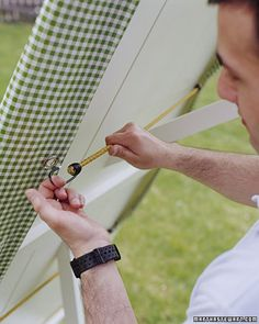 Insert grommets onto a tablecloth, then use bungee cords to keep it from lifting up in the wind.  Smart!