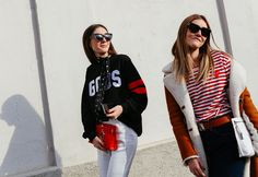 In a Loewe belt and clutch (left) and Comme des Garçons shirt (right)
