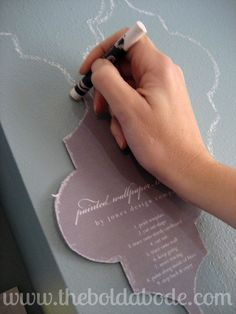 Stenciling the wall with a Whiteboard Crayon