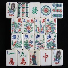 152 vintage, 1920s beautiful, hand carved and painted, ½ ox bone and ½ bamboo, dovetailed mahjong tiles. This set features wonderful one bamboos, one dots and two fantastic flower bouquets, all fancy carved.