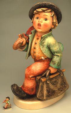 hummel figurines value list | Jumbo Merry Wanderer shown beside 4-inch Merry Wanderer