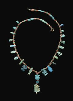 AN EGYPTIAN GLAZED COMPOSITION BEAD NECKLACE 2ND-1ST MILLENNIUM B.C. AND LATER