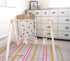 wooden baby gym scandi inspired Pink, lavender, Wood Baby Gym Toy Play Gym PlayGym Timber Wooden BabyGym Baby Centre by styledbynaomi on Etsy https://www.etsy.com/uk/listing/471101850/pink-lavender-wood-baby-gym-toy-play-gym
