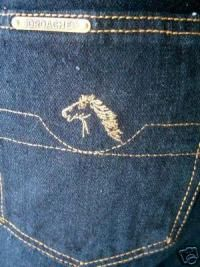 These were the ONLY jeans to wear when Skating at Spinning Wheels.  Don't forget the comb for your back pocket.