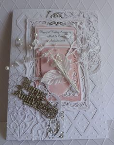 An anniversary card using a mix of spellbinders  & Marianne