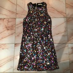 Sequin dress ✨ Only wore once on New Year Eve! Seriously the cutest multi colored sequin dress. Purchased at a boutique Do & Be Dresses Mini