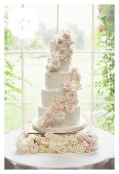 Modern striking sugar rose cascade floral wedding cake (photo credit: Jojo Stott photography)