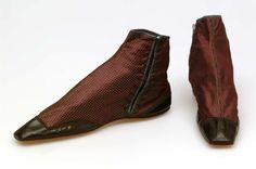 Ladies brocade ankle boots with patent leather toe and heel caps. These boots would have laced up at the sides. 1850