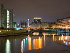 Embankment of Spree river at night in Berlin, Germany