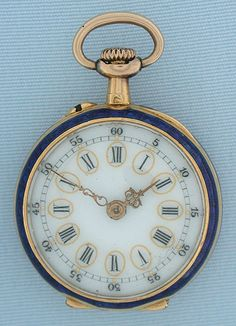 Lovely 18K gold and enamel miniature antique ladies pendant watch by LeCoultre circa 1890. The bezel and back in cobalt blue enamel, the back enameled over elaborate floral engraving. Fancy enamel dial with fancy gold hands.