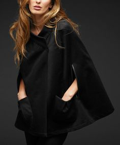 Elegant and posh, this cape will be a layer to love. A lavish fabric, leather trim and a distinct low collar add a fashionable finish.Body: 95% polyester / 5% spandexTrim: 100% leatherDry cleanMade in the USA