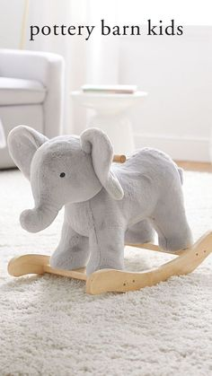 Little ones can go on a make-believe jungle adventure with our super plush critter elephant rocker. Sweet and huggable, it features solid wood handles and precision-shaped runners for a smooth, secure and gentle rocking motion. Nursery Rocker, Elephant Nursery, Kids Store, Baby Safe, Custom Rugs, Safari Animals, Pottery Barn Kids, Little Ones, Baby Gifts
